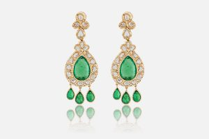 Yellow gold earrings set with emeralds