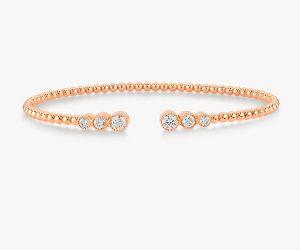 Un-bracelet-jonc-intemporel-en-or-rose-18K diamants
