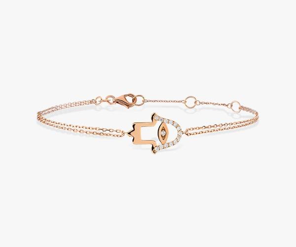 Gourmette-diamants-en-or-rose-18K-avec-une-pièce-centrale-en-forme-de-Khmissa-