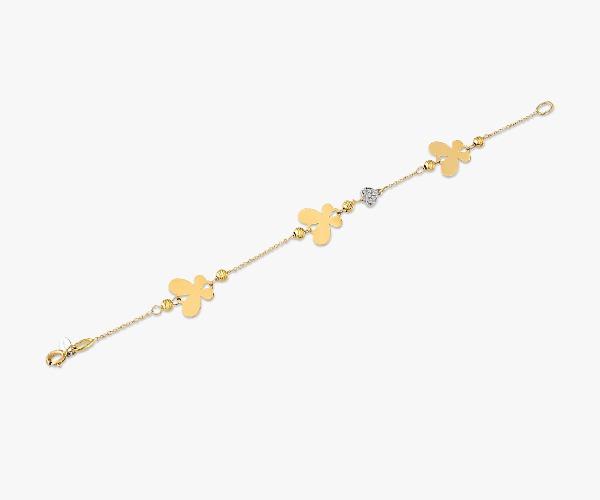 Gourmette-en-or-jaune-18K-composée-de-trois-papillon-en-or-poli-et-un-pavé-de-diamants-pour-un-doux-éclat