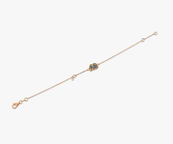 Gourmette-ludique-en-or-rose-18K-orné-d'un-motif-en-forme-d'éléphant-avec-un-petit-diamant-pour-un-doux-éclat