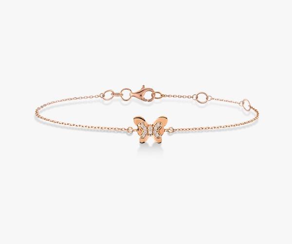 Gourmette-diamants-en-or-rose-18K-avec-une-pièce-centrale-en-forme-de-papillon-